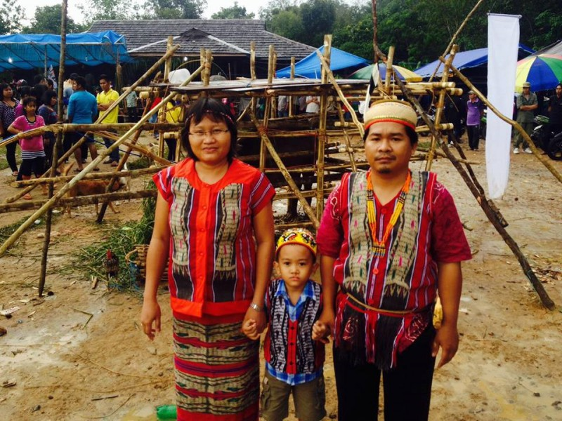 Masrani and his wife and son before the sumpah adat last year. Photo courtesy of Masrani